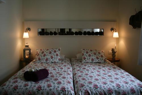 A bed or beds in a room at CASA LEOPOLDO CAMINO DE SANTIAGO