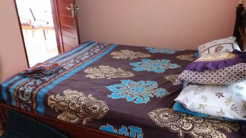 A bed or beds in a room at villa Cempaka