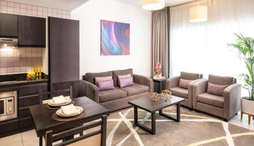 Гостиная зона в Citadines Metro Central Apartments