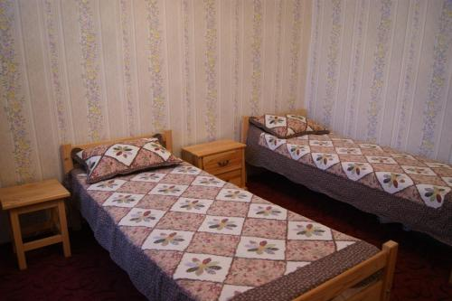 A bed or beds in a room at Квартира №1