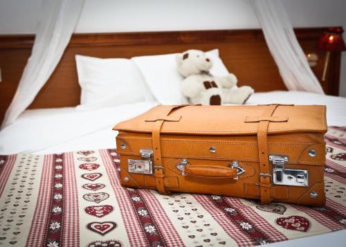 A bed or beds in a room at Brit Hotel Confort La Ferme du Pape