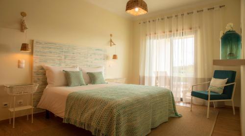 A bed or beds in a room at Apartamento do Cercado