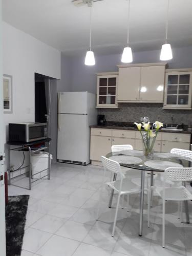 A kitchen or kitchenette at Isla Verde Aptm