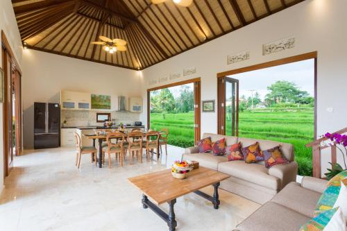 A seating area at Champaca Luxury Villas Ubud