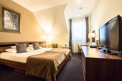 Łóżko lub łóżka w pokoju w obiekcie Rado Resort Spa & Wellness