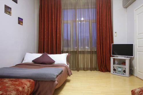 Кровать или кровати в номере Business Apartment Moskva-city