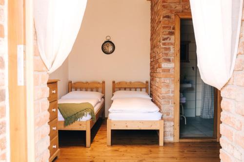 Postel nebo postele na pokoji v ubytování Starý Svět