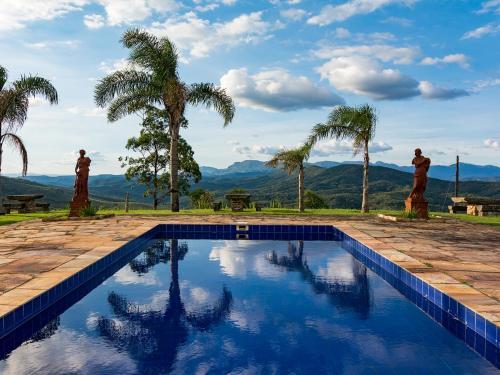 The swimming pool at or near Vila Relicário