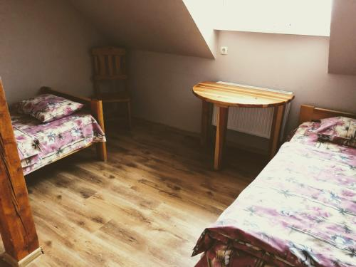 A bed or beds in a room at Atpūtas centrs Paideri