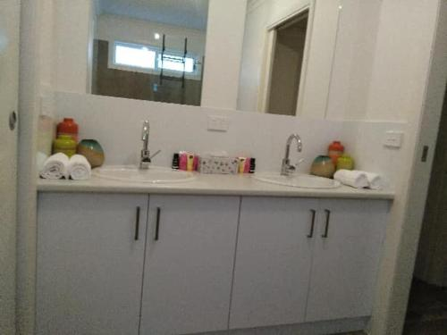A kitchen or kitchenette at All seasons holiday homes