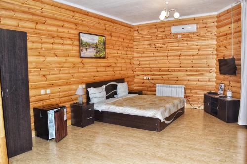 Кровать или кровати в номере Hotel Zapovednik