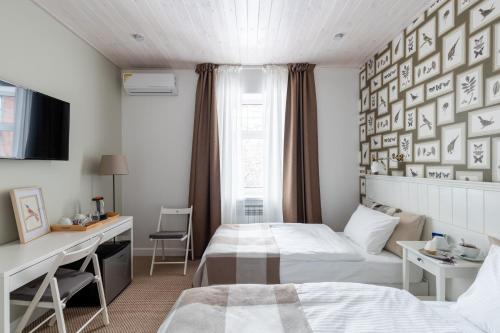Кровать или кровати в номере Hotel Snegir