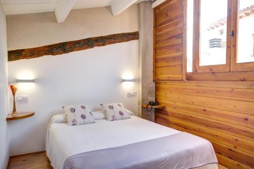 Cama o camas de una habitación en Hotel La Freixera