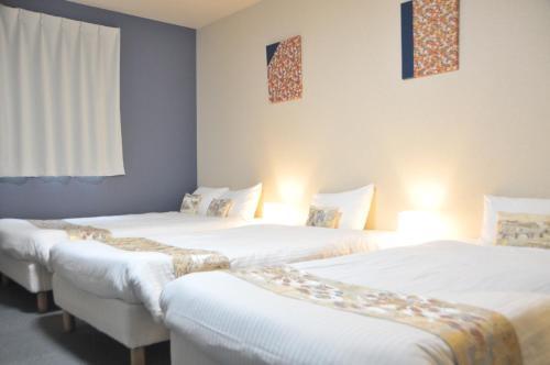 Stay SAKURA Kyoto 東寺南Ⅱにあるベッド