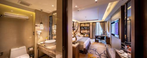 Um banheiro em Braira Hotel-Olaya