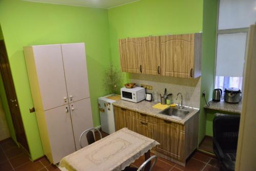 A kitchen or kitchenette at Guest House Dostoevsky