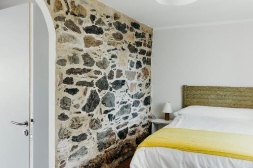 A bed or beds in a room at EL RETIRO DE LA LUNA