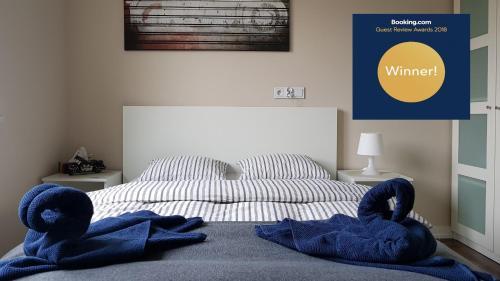 Łóżko lub łóżka w pokoju w obiekcie Komfortowy apartament