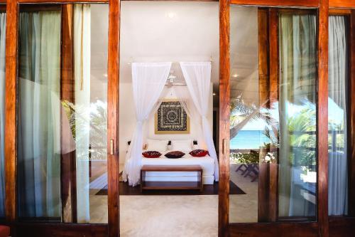 Кровать или кровати в номере The Beach Tulum