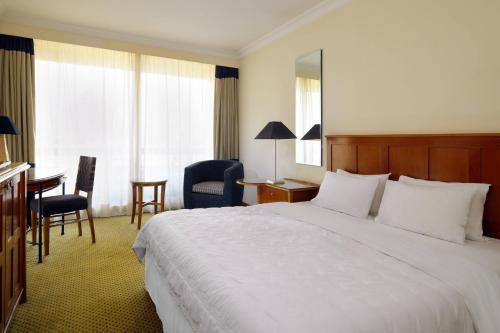 A bed or beds in a room at Le Meridien Pyramids Hotel & Spa