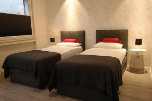 A bed or beds in a room at Minsu Hotel