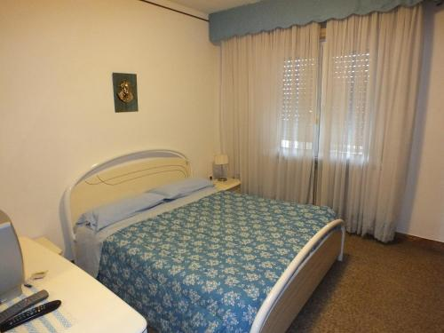 A bed or beds in a room at La Casa di Lisa a 20 km dal mare