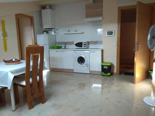 A kitchen or kitchenette at Hostal Caminito