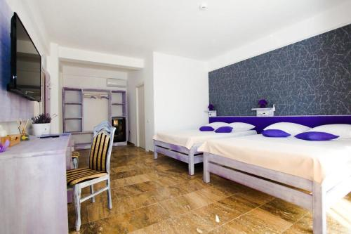 A bed or beds in a room at Lavender Villa