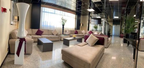 Predel za sedenje v nastanitvi Tiby Hotel