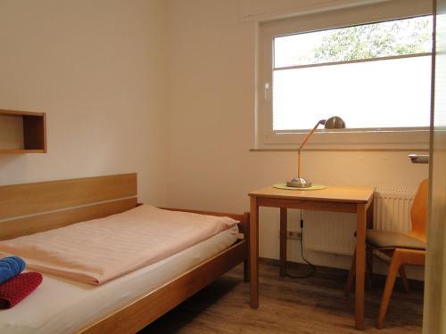 Ein Bett oder Betten in einem Zimmer der Unterkunft Haus St. Josef