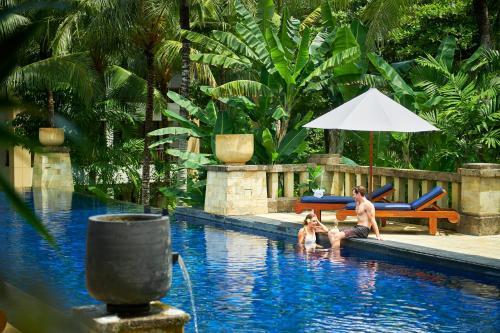 The swimming pool at or near Conrad Bali