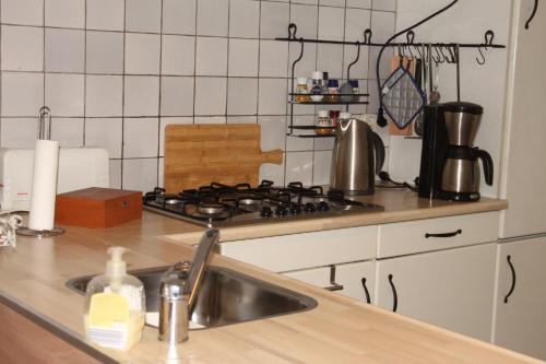 Een keuken of kitchenette bij B&B De Rumelshof