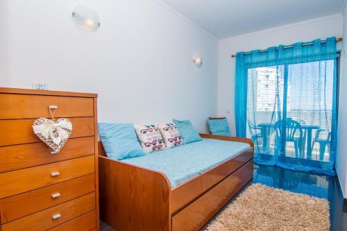 Cama o camas de una habitación en Apartamentos Turisticos Rocha Tower - MI