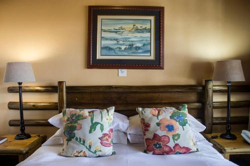A bed or beds in a room at Riverside Lodge & Conference Center
