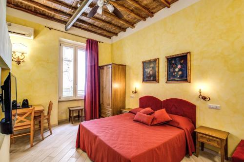 A bed or beds in a room at Residenza San Calisto