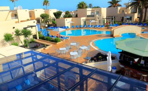 A view of the pool at Alisios Playa or nearby