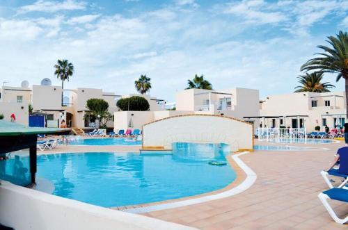 The swimming pool at or near Alisios Playa