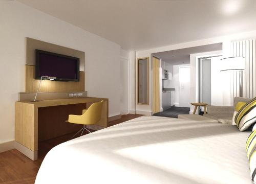 A bed or beds in a room at Residence Inn by Marriott Edinburgh