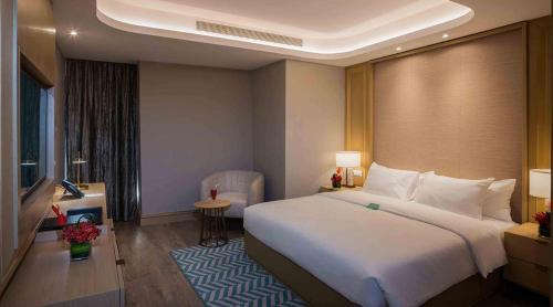 Cama ou camas em um quarto em Boudl Al Olaya
