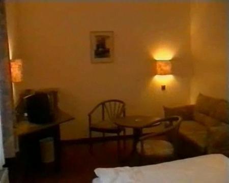 A seating area at Hotel Merkur Garni