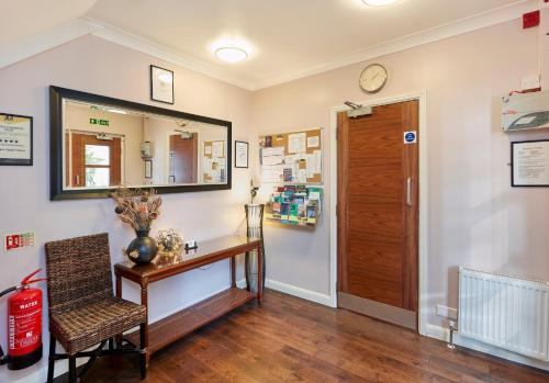 The lobby or reception area at Conifers Guest House