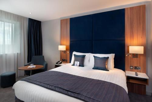 A bed or beds in a room at Crowne Plaza London Heathrow T4, an IHG Hotel