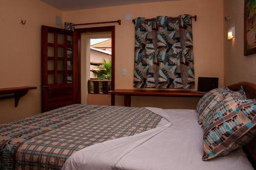 A bed or beds in a room at Hotel Alta Vista