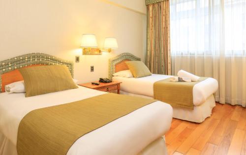 Cama o camas de una habitación en Hotel Frontera Clásico