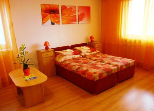Posteľ alebo postele v izbe v ubytovaní Penzion Fortuna Dudince