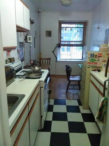 A kitchen or kitchenette at 2187 Cruger Avenue
