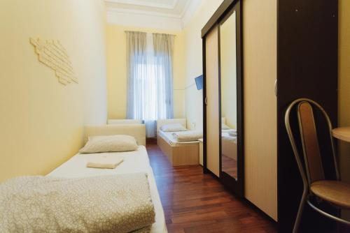A bed or beds in a room at Pathos near Kremlin