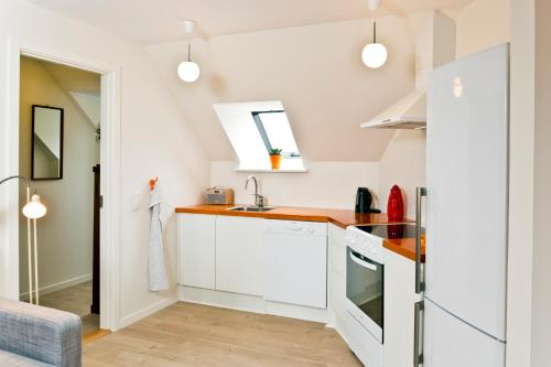 Køkken eller tekøkken på Aroma Guesthouse