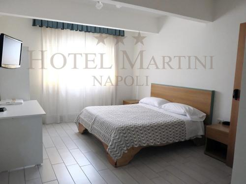 A bed or beds in a room at Hotel Martini