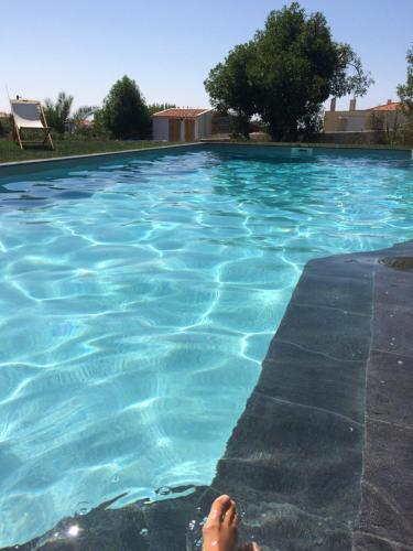 The swimming pool at or near Elemental Ericeira
